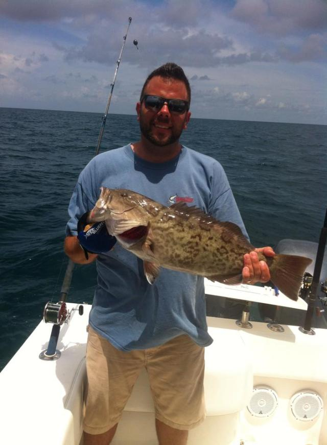 The hubs caught a grouper out on the boat.  Yummmmmmm!
